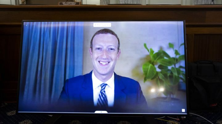 Facebook CEO Mark Zuckerberg appears on a screen as he speaks remotely during a hearing before the Senate Commerce Committee on Capitol Hill, Wednesday, Oct. 28, 2020,