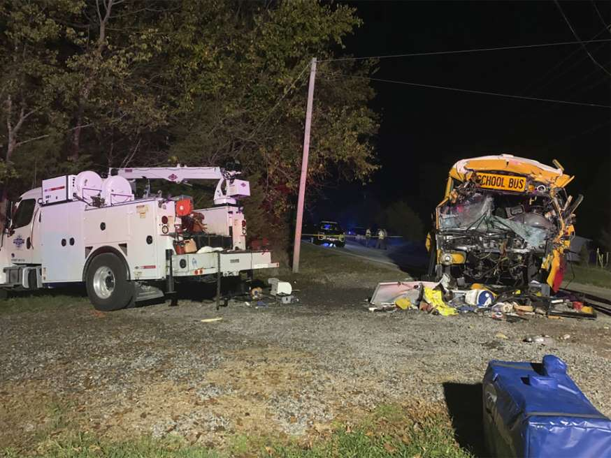This photo provided by the Tennessee Highway Patrol shows the scene of deadly crash involving a utility vehicle and a school bus carrying children on Tuesday evening, Oct. 27, 2020, in Decatur, Tenn.