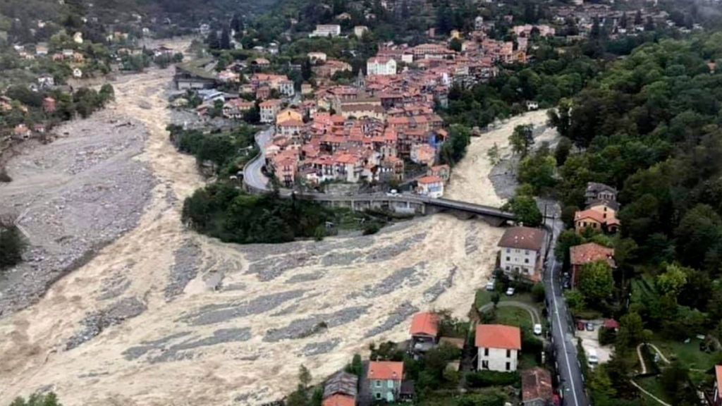 This aerial view provided Sunday Oct.4, 2020 by the Alpes Maritimes region fire brigade show a house keeping a fragile balance on a hill while a rive floods Saturday Oct.3. 2020 near La Vesubie, southern France.