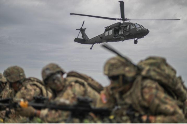 Pictured, members of the U.S. Army's 2nd Cavalry Regiment practice an air assault exercise.
