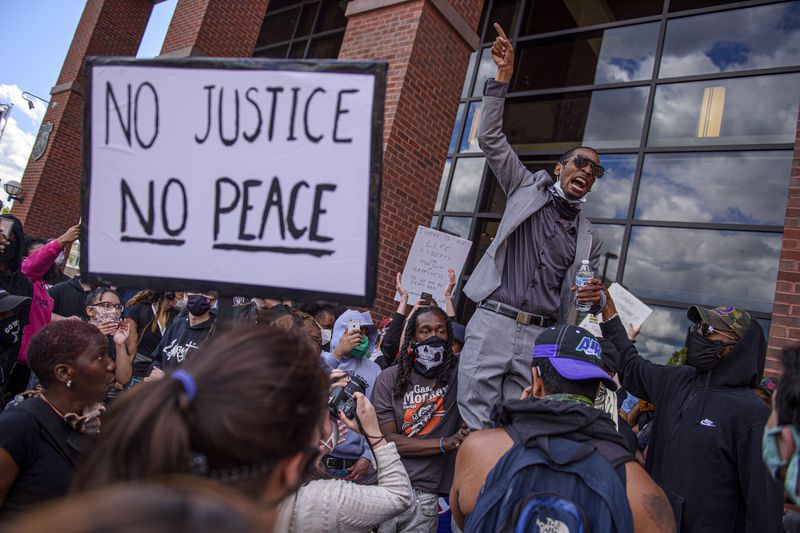 Protestors stop at the Hartford Public Safety Complex as an estimated 500 or more people marched through the city after the death of George Floyd at the hands of Minneapolis police officers on Memorial Day.