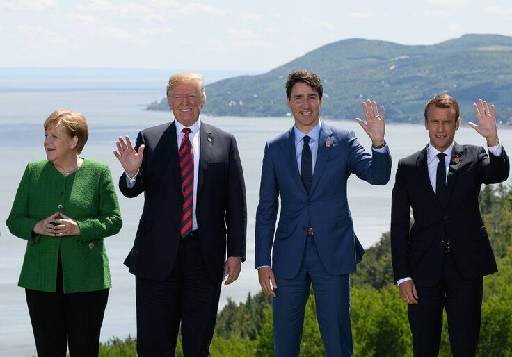 German Chancellor Angela Merkel, U.S. President Donald Trump, Canadian Prime Minister Justin Trudeau, and French President Emmanuel Macron.