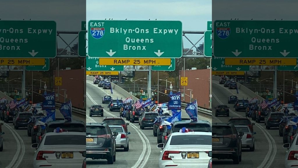 A caravan of Trump supporters driving through NYC, prominently displaying Trump 2020 flags.