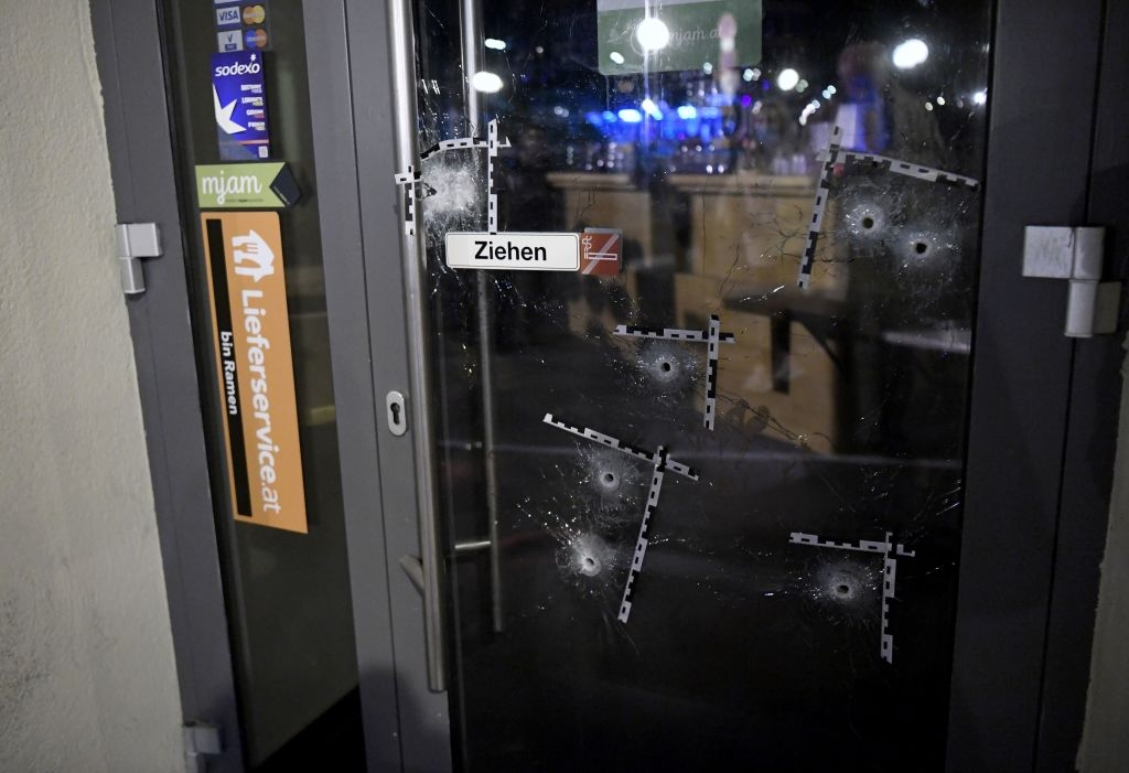 The door of a restaurant, riddled with bullet holes, in Vienna, Austria on November 3, 2020, the day after a terror attack in which four people were killed.