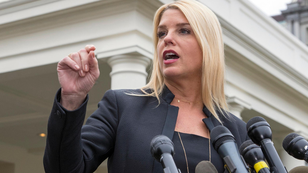 FILE - In this Feb. 22, 2018 file photo, Florida Attorney General Pam Bondi, speaks to reporters outside the West Wing in Washington.