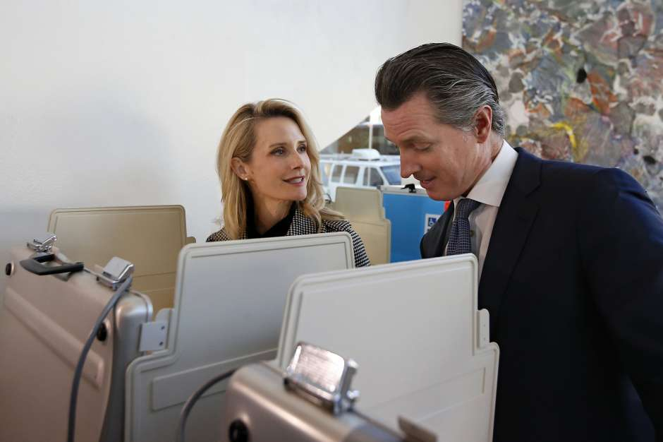 Gov. Gavin Newsom and his wife, Jennifer Siebel Newsom, as they vote in the California primary on March 3 in Sacramento. The couple attended a party at the French Laundry restaurant in Napa on Nov. 6 that included people from several households, the type of gathering Newsom's administration has discouraged during the coronavirus pandemic. Photo: Rich Pedroncelli / Associated Press