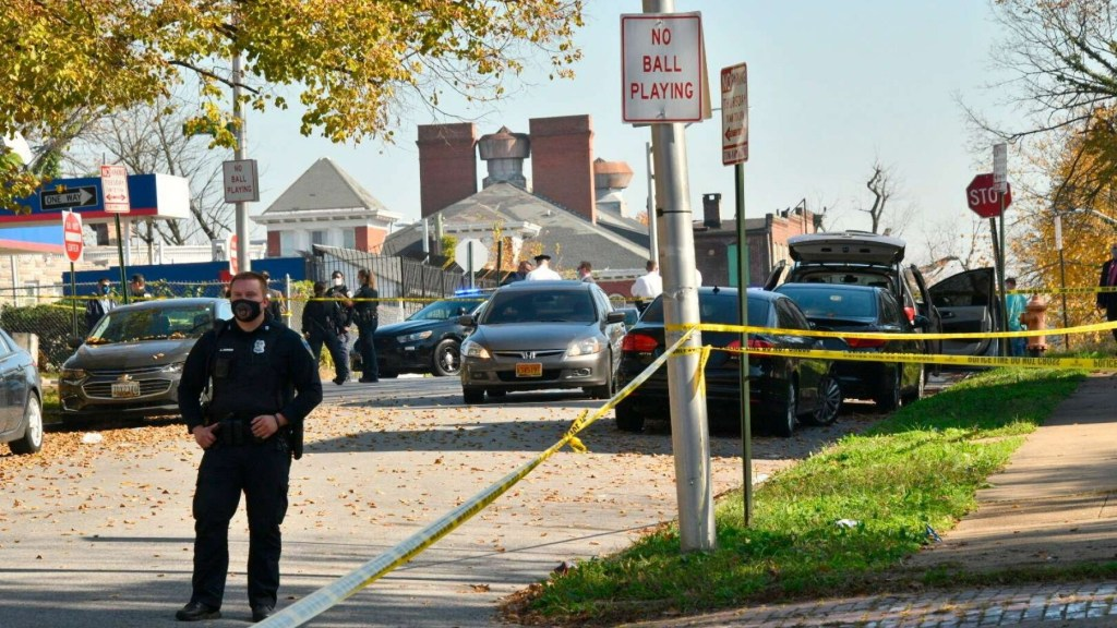 Baltimore police investigate the scene of a shooting in the city's Rosemont neighborhood Monday morning, Nov. 9, 2020.