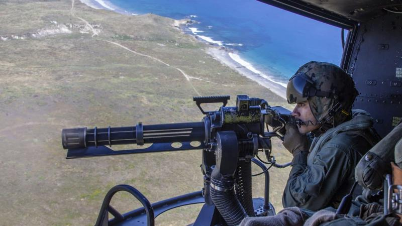 Sgt. Eric Landin, a crew chief with Marine Light Attack Helicopter Squadron 469, Marine Aircraft Group 39, 3rd Marine Aircraft Wing, fires a GAU-17 machine gun from a UH-1Y Venom helicopter during aerial gunnery training to meet annual qualifications over San Clemente Island, California, April 22, 2020.