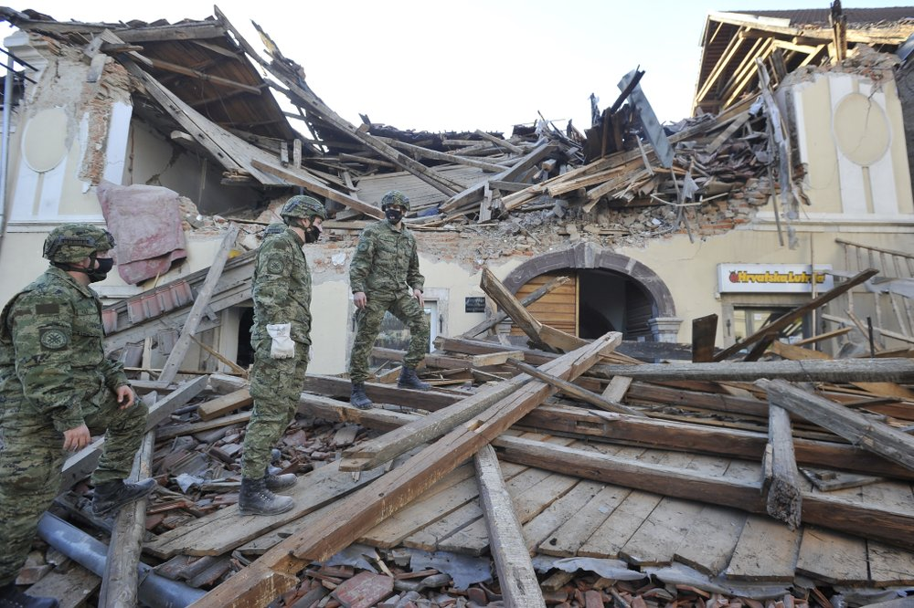 Soldiers inspect the remains of a building damaged in an earthquake, in Petrinja, Croatia, Tuesday, Dec. 29, 2020. A strong earthquake has hit central Croatia and caused major damage and at least one death in a town southeast of the capital.