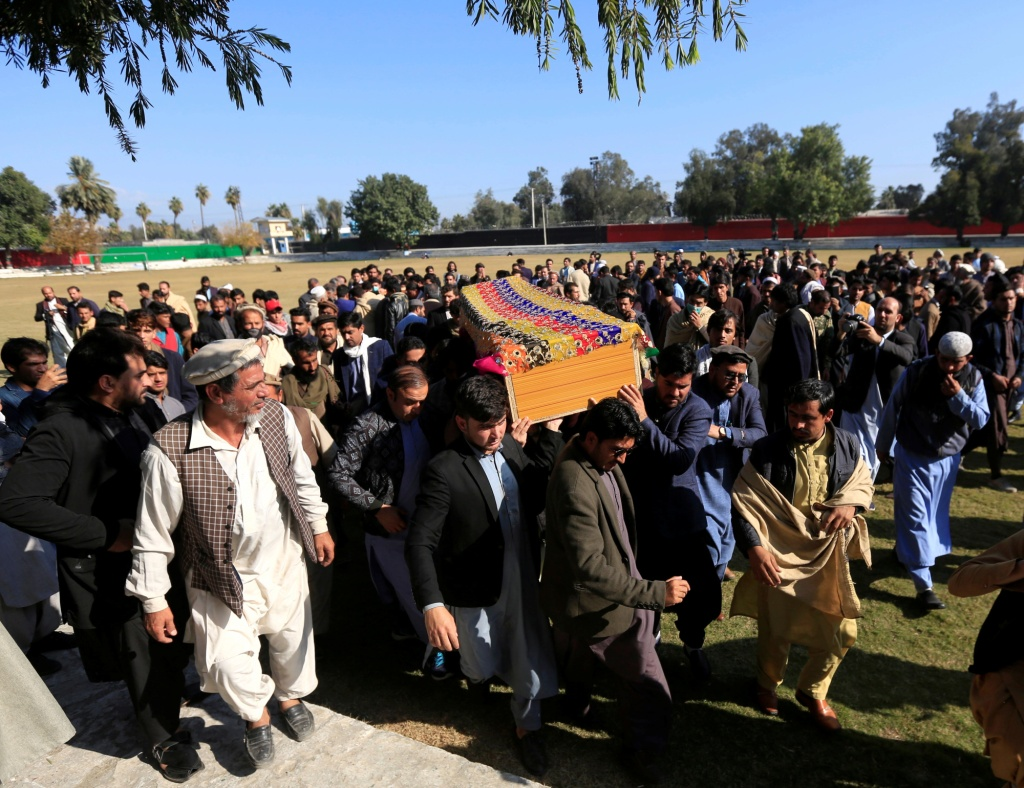 Afghan men carry the coffin of journalist Malalai Maiwand, who was shot and killed on her way to work in Jalalabad, Afghanistan, on December 10, 2020.