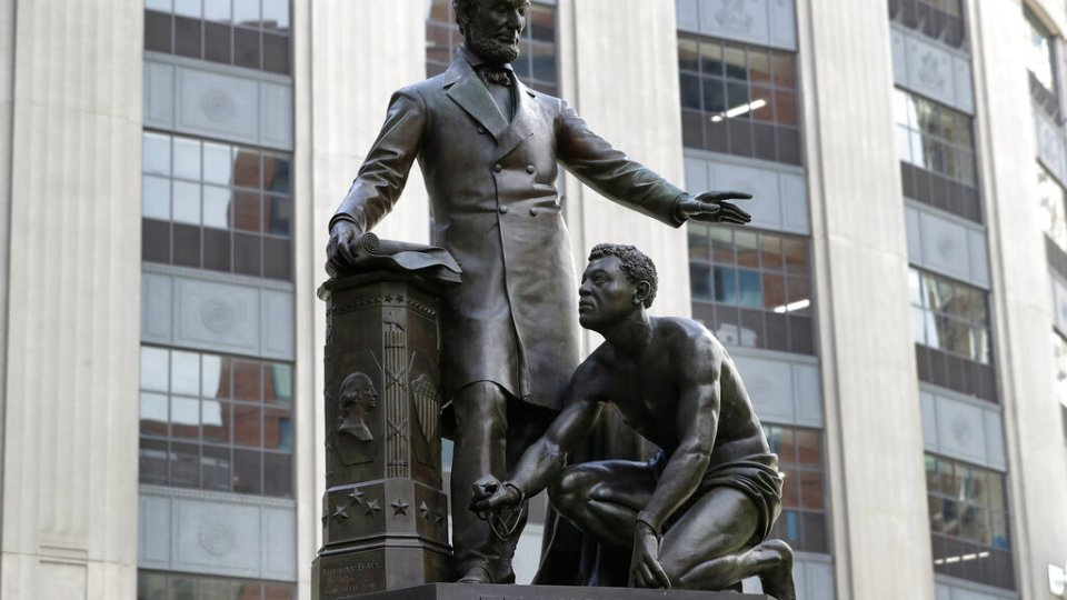 In this June 25, 2020, file photo, a statue that depicts a freed slave kneeling at President Abraham Lincoln's feet rests on a pedestal in Boston. On Tuesday, Dec. 29, the statue that drew objections amid a national reckoning with racial injustice was removed from its perch.