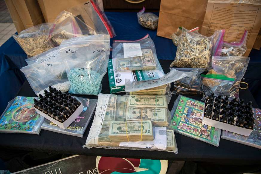 Local law enforcement displays drugs and money during a press conference that was confiscated from a recent arrest in connection with a local drug trafficking operation in Texas. Friday,