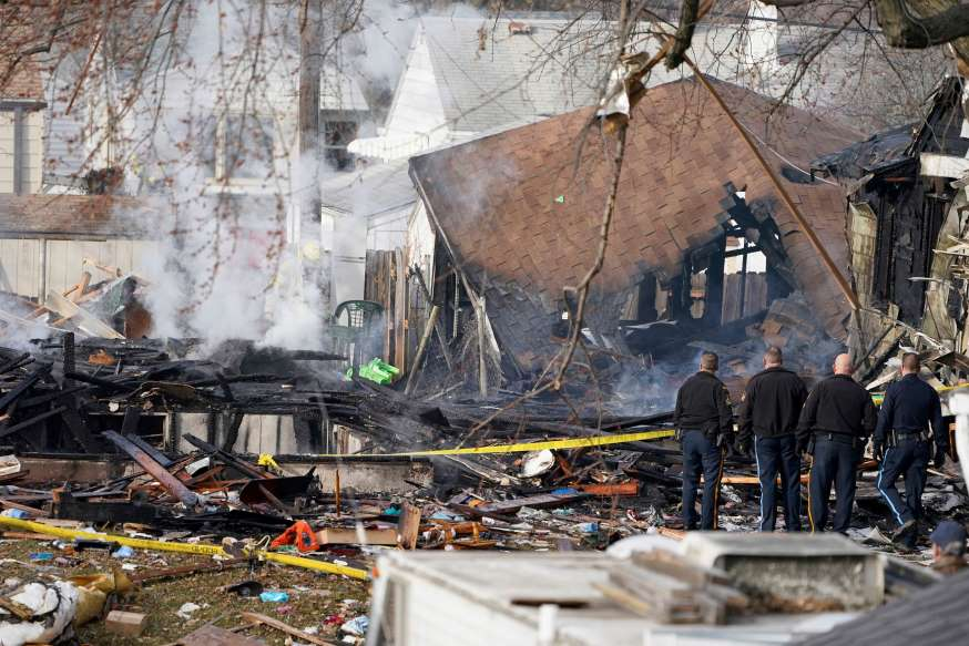 Police officers stand at the scene of a deadly explosion that leveled a home in Omaha, Neb., Tuesday, Dec. 8, 2020. (AP Photo/Nati Harnik)