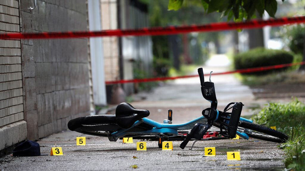 Shell casing markers are seen where a 37-year-old man riding a bicycle was shot and pronounced dead at the hospital, according to local media reports, on the West Side of Chicago, July 26, 2020.