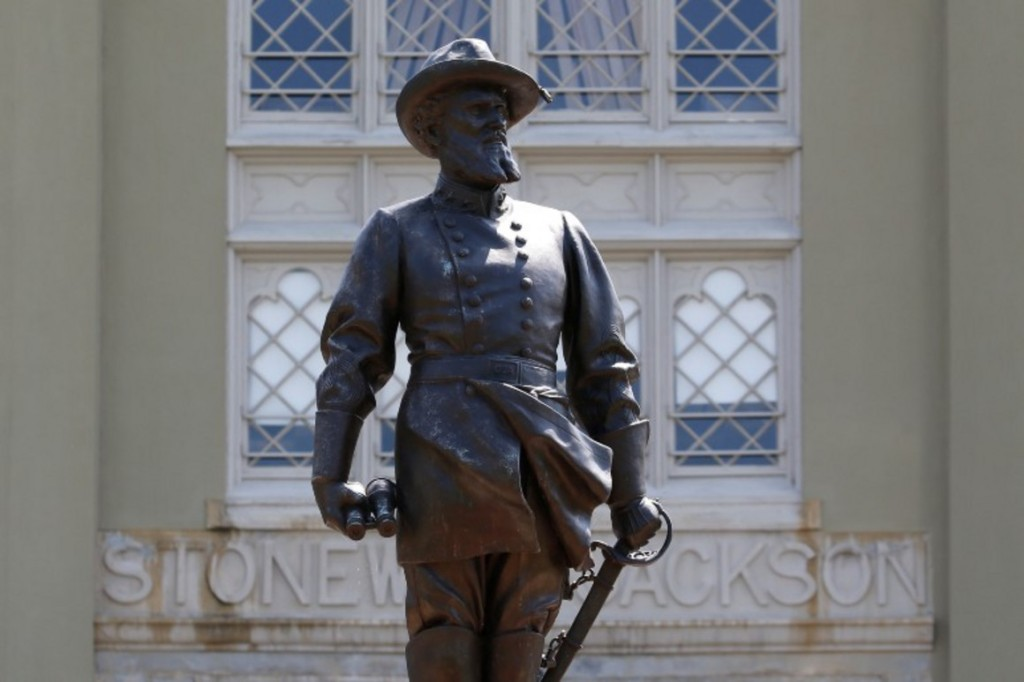 A statue of Confederate General Stonewall Jackson stands behind canons at the entrance to the barracks at Virginia Military Institute Wednesday July 15, 2020, in Lexington, Va.