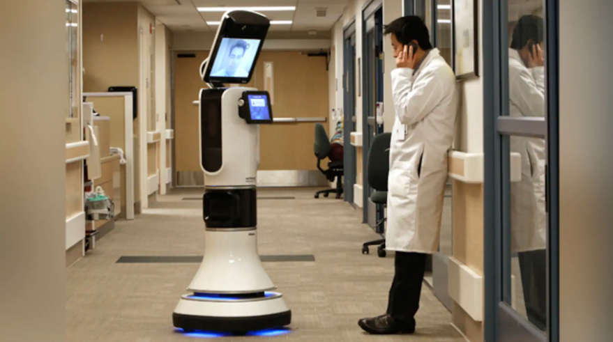 Dr. Alan Shatzel, medical director of the Mercy Telehealth Network, is displayed on the monitor RP-VITA robot as he waits to confer with Dr. Alex Nee at Mercy San Juan Hospital in Carmichael, Calif.