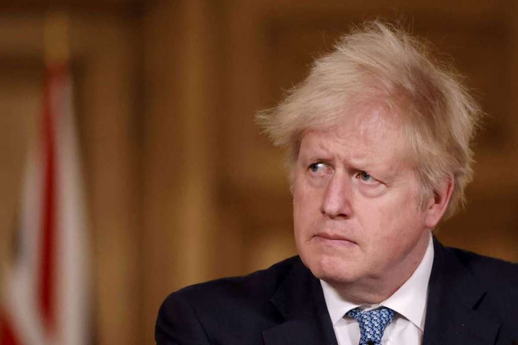 Britain's Prime Minister Boris Johnson speaks during a media briefing in Downing Street, London, Monday Dec. 21, 2020.