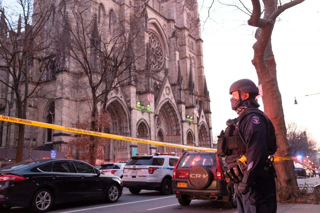 Police respond after a shooting outside a Cathedral in Manhattan. (Gardiner Anderson/New York Daily News/TNS)