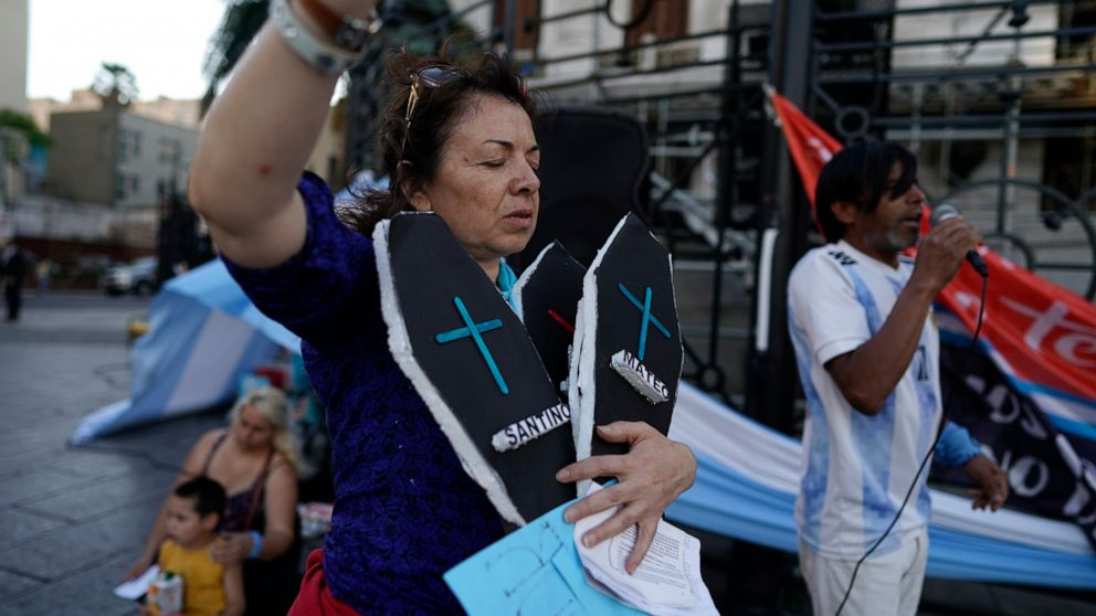 A demonstrator against abortion holds two fake coffins as she protests against the legalization of abortion, a day after President Alberto Fernández sent a bill to legalize abortion, outside Congress in Buenos Aires, Argentina, Wednesday, Nov. 18, 2020.