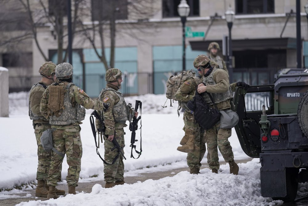 National guard members stage outside a museum Tuesday, Jan. 5,