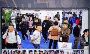 A screen shows visitors being filmed by artificial intelligence security cameras with facial recognition technology at the 14th China International Exhibition on Public Safety and Security at the China International Exhibition Centre in Beijing on Oct. 24, 2018.