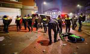 Police officers clashed with young people in Rotterdam, the Netherlands. Photograph: Marco de Swart/EPA