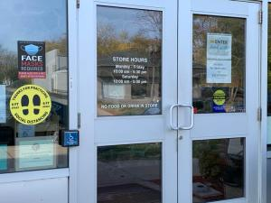 A thrift store in Reotown posts signs notifying customers of a statewide mask mandate that's being challenged in court.
