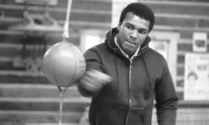 Muhammad Ali punches a bag in his Deer Lake, Pa., training camp where he was preparing for his rematch with Joe Frazier, on Jan.10, 1974.
