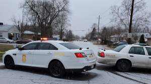 Indianapolis Metropolitan Police Department work the scene Sunday, Jan. 24, 2021, in Indianapolis where five people, including a pregnant woman, were shot to death early Sunday inside an Indianapolis home.