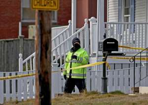 Wakefield MA. - January 19:Police investigate a home on Otis Street where police shot a man during an investigation into the death of a woman inside on January 19, 2021 in Wakefield, MA.