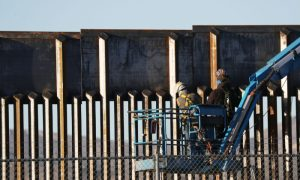 People work on the U.S.-Mexico border wall in El Paso, Texas, on Feb. 12, 2019.
