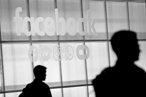 The Facebook logo is displayed during a conference. | Photo by Justin Sullivan/Getty Images
