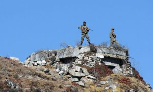 Indian Army personnel stand guard at Bumla pass at the India-China border in Arunachal Pradesh on Oct. 21, 2012.