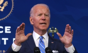 President-elect Joe Biden speaks as he lays out his plan for combating the coronavirus and jump-starting the nation's economy at the Queen theater in Wilmington, Delaware, on Jan. 14, 2021.