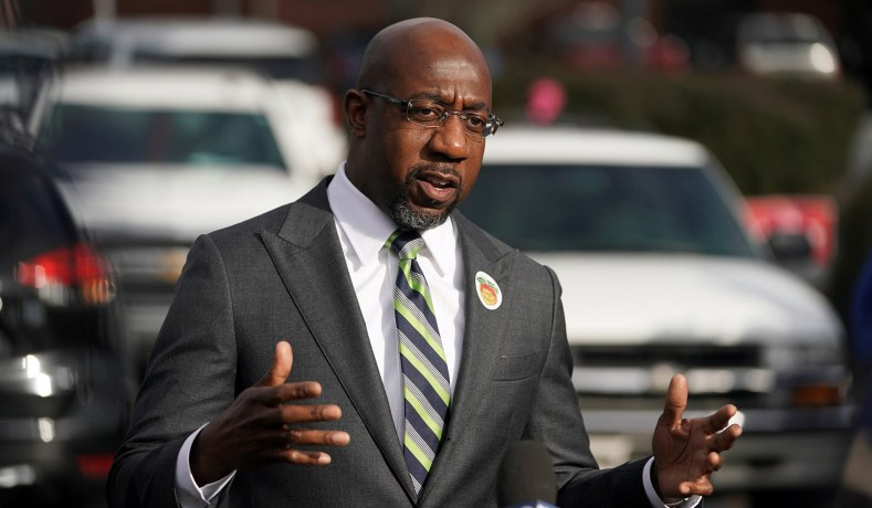 Democratic Senate candidate Raphael Warnock speaks to the media as early voting in two run-off elections begins in Atlanta, Ga., December 14, 2020.
