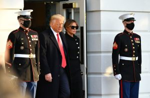 Then-President Donald Trump and First Lady Melania make their way to board Marine One before departing from the South Lawn of the White House in Washington on Jan. 20, 2021.