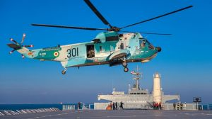 This image released Thursday, Jan. 14, 2021, by the Iranian Army shows a helicopter hovering over the Iranian-made Makran logistics vessel during a naval drill.