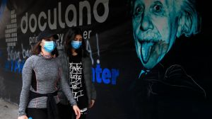 Lebanese women wear masks to help prevent the spread of the coronavirus, in Beirut, Lebanon, Wednesday, Jan. 27, 2021.