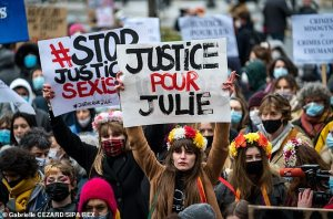 Pictured: Dozens of people gathered on February 7 in Paris to demand 'Justice for Julie'. Ten years ago, Julie, 13 years old, was raped by about twenty firemen in a Parisian fire station.