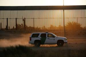 A US Customs and Border Protection vehicle patrols a new section of the border wall in El Paso, Texas, as seen from Ciudad Juarez, Mexico, on August 27, 2020.