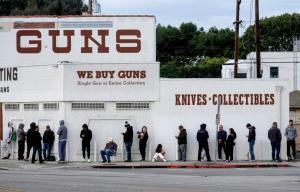 In this March 15, 2020, file photo, people wait in line to enter a gun store in Culver City, Calif.