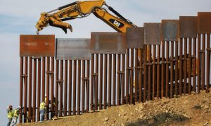 A construction crew installs new sections of the U.S.-Mexico border barrier as seen from Tijuana, Mexico on Jan. 11, 2019.