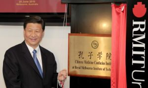 Chinese leader Xi Jinping unveils the plaque at the opening of Australia's first Chinese Medicine Confucius Institute at the RMIT University in Melbourne on June 20, 2010.