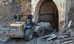 Indo Tibetan Border Police personnel are using machinery to clear mud as they try to rescue more than three dozen power plant workers trapped in a tunnel in the Tapovan area of the northern state of Uttarakhand, India, on Feb. 8, 2021.