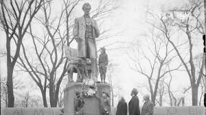 Four Boy Scouts standing at the Lincoln Monument, designed by Augustus Saint Gaudens, in Lincoln Park in Chicago, Ill., in 1929.