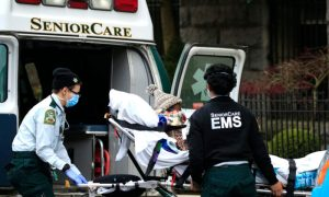 File photo showing emergency medical workers unloading a patient outside a nursing home in Brooklyn, New York,