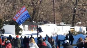 "Dion Cini carrying ""Trump 2024"" flag at the Wollman Rink in New York City. Twitter/Screenshot"