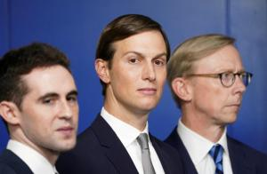 White House adviser Jared Kushner, flanked by aide Avi Berkowitz (L) and Brian Hook, former U.S. envoy to Iran, during a press briefing on the agreement between Israel and the United Arab Emirates at White House in Washington.