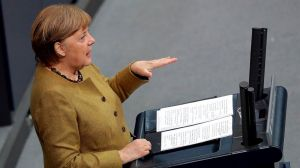 German Chancellor Angela Merkel delivers a speech during a meeting of the German federal parliament, Bundestag, at the Reichstag building in Berlin, Germany, Thursday, Feb. 11,
