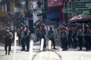 Armed police stand guard on a major street to preven anti-coup demonstration in Yangon, Myanmar, Friday, March 5, 2021. Footage of a brutal crackdown on protests against a coup in Myanmar has unleashed outrage and calls for a stronger international response.